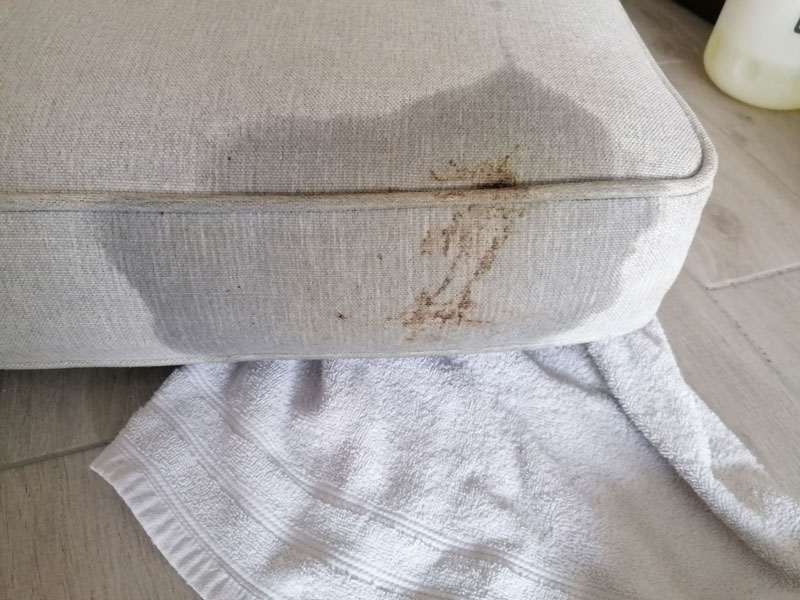 stain on grey cushion